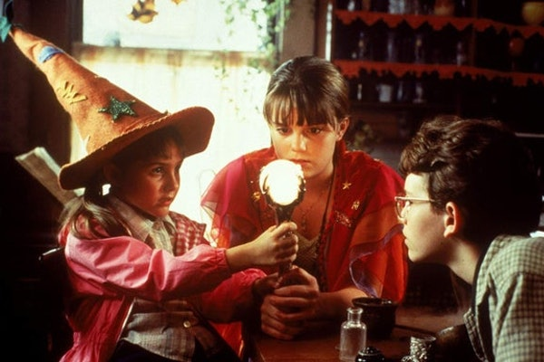 Marney and her siblings gather around a crystal ball in 'Halloweentown.'