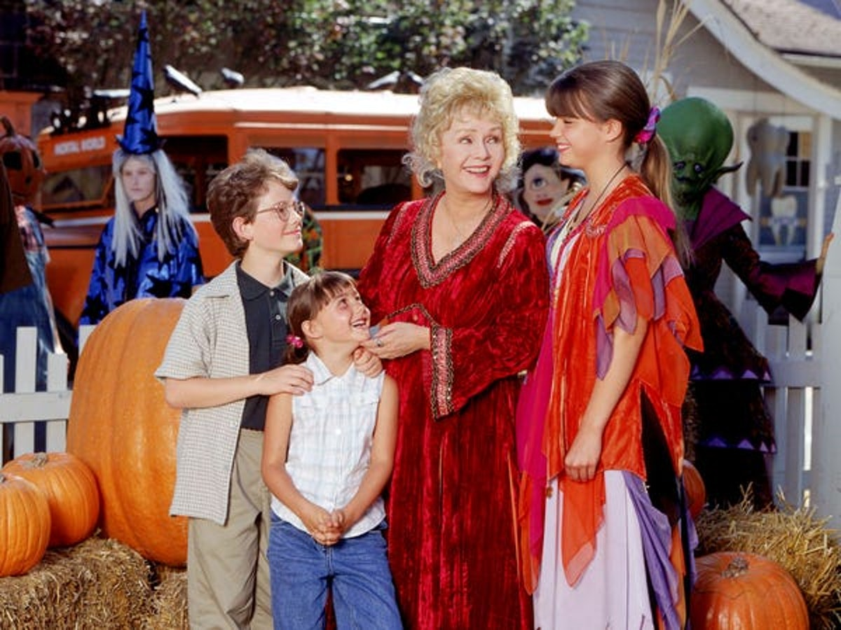 The main characters from 'Halloweentown' gather in the town square, surrounded by bales of hay and p...