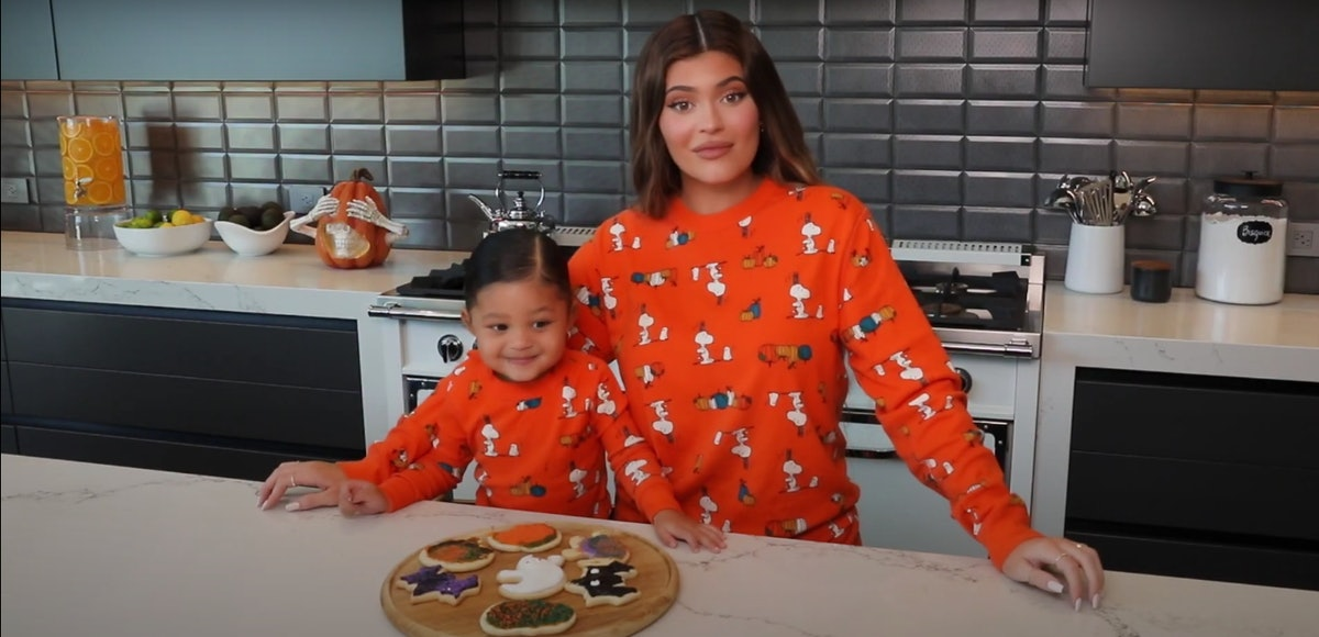 Kylie Jenner and daughter Stormi bake cookies.