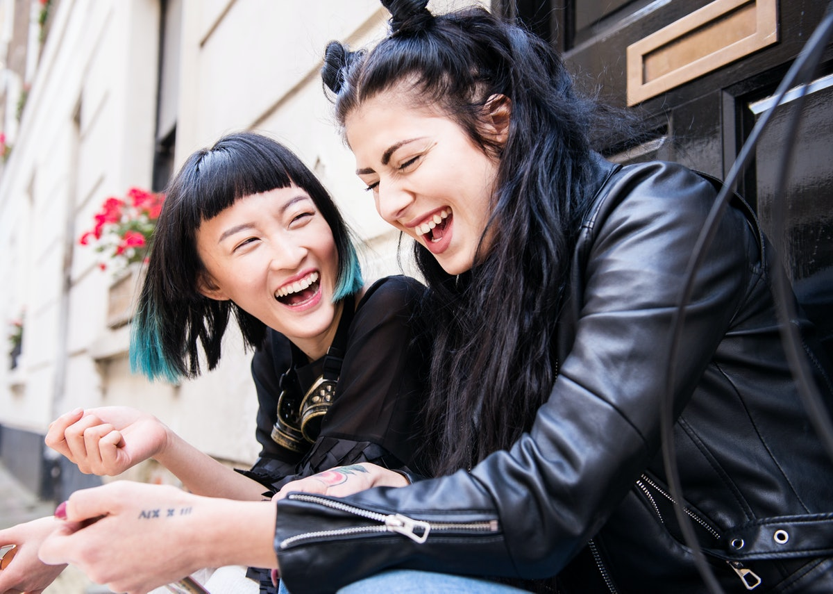 2 young women wearing leather jackets