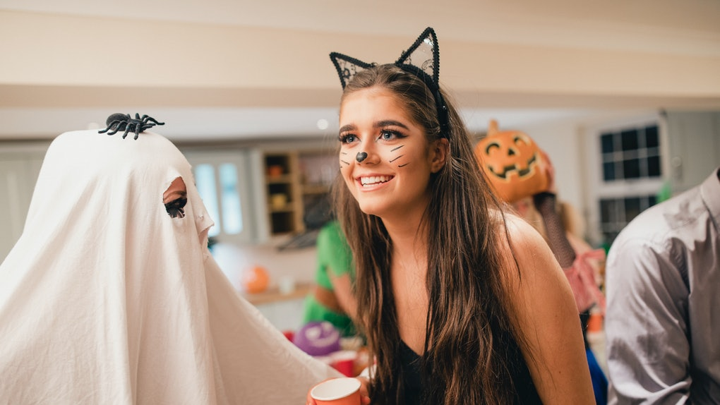 Young woman in cat Halloween costume