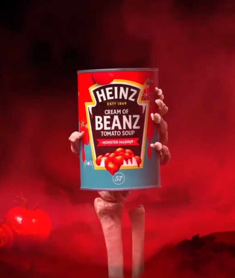 A tin of Heinz cream of beanz tomato soup with a red label and skeleton hand clutching it