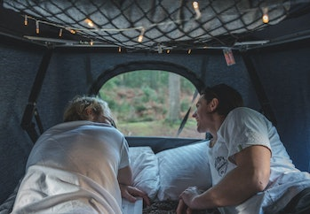 Two people in the TentBox Classic looking through a window.
