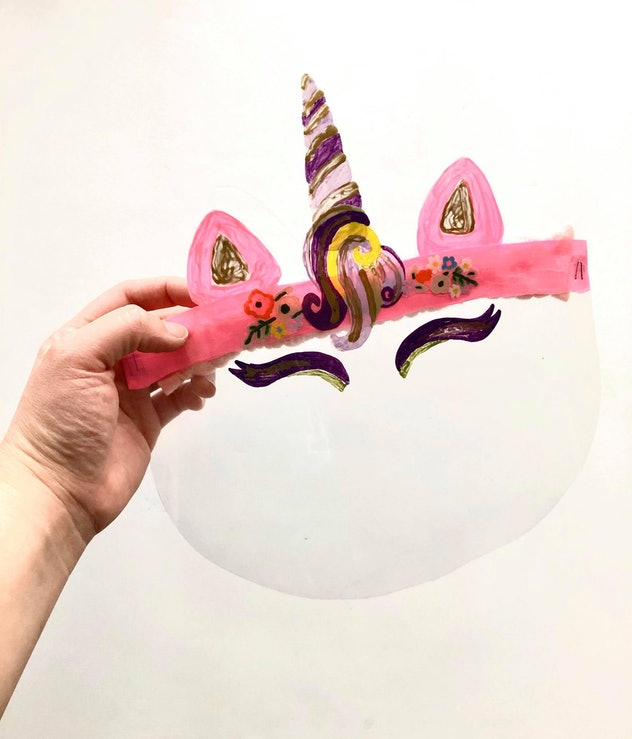 Decorated face shields are a great way to craft some Halloween fun and stay safe.