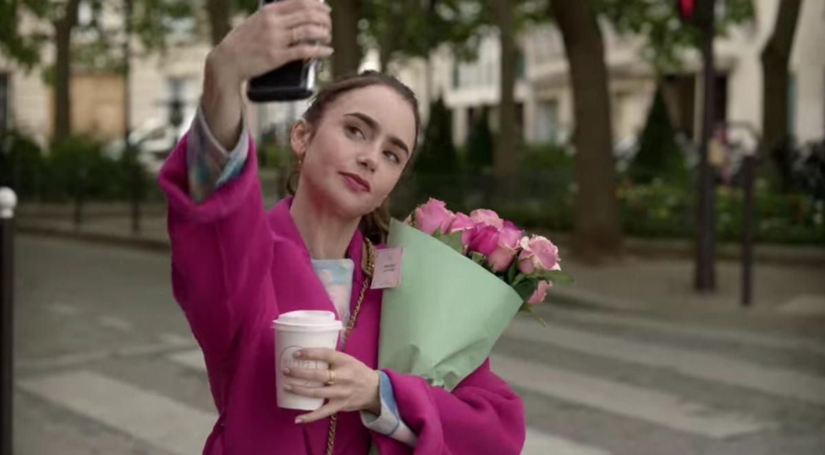 Emily (Lily Collins) takes a selfie with a fresh bouquet of roses and coffee.
