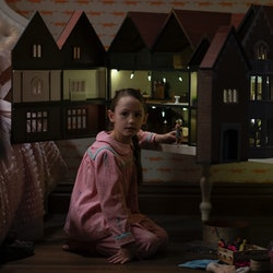 Flora and her dollhouse in 'The Haunting of Bly Manor' via the Netflix press site