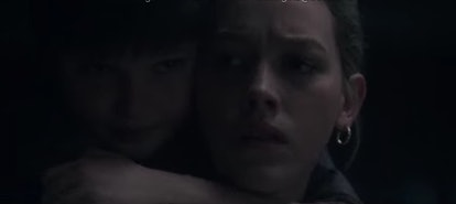 Miles wraps his arms around Dani's neck in 'The Haunting of Bly Manor'