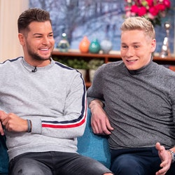 Chris and Ben Hughes appearing on ITV's this morning, both wearing grey jumpers with jeans and smiling