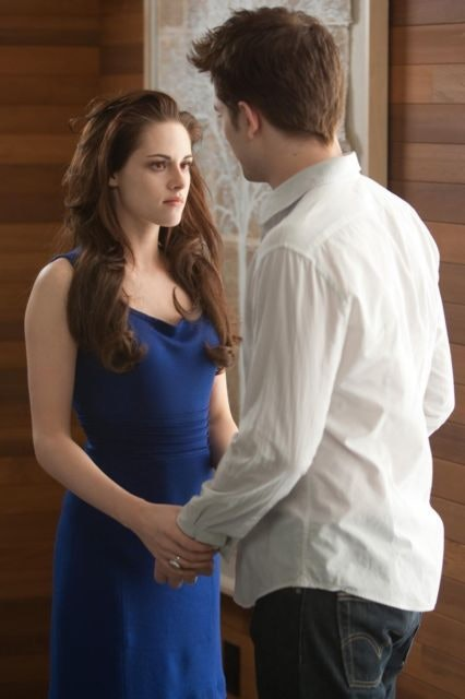 Newborn Bella Swan and Edward Cullen in 'Breaking Dawn' holding hands.