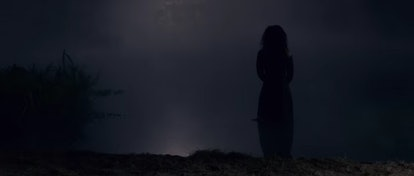 Miss Jessel's ghost standing by the lake in  'The Haunting of Bly Manor'