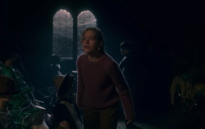 Miles hits Dani over the head in  'The Haunting of Bly Manor'