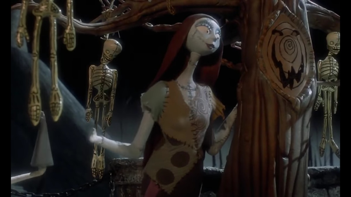 """Sally from """"Nightmare Before Christmas"""" surrounded by dangling skeletons."""