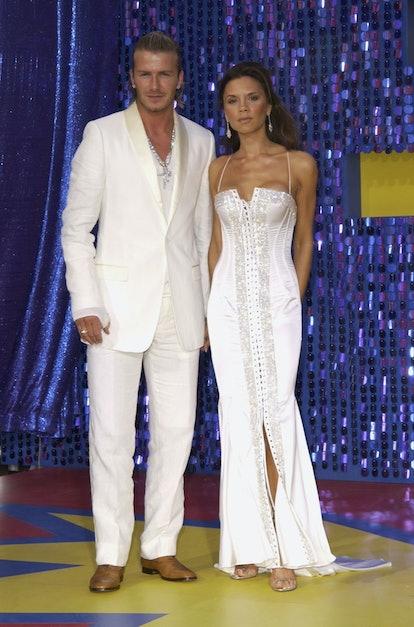 David and Victoria beckham wearing matching all-white ensembles