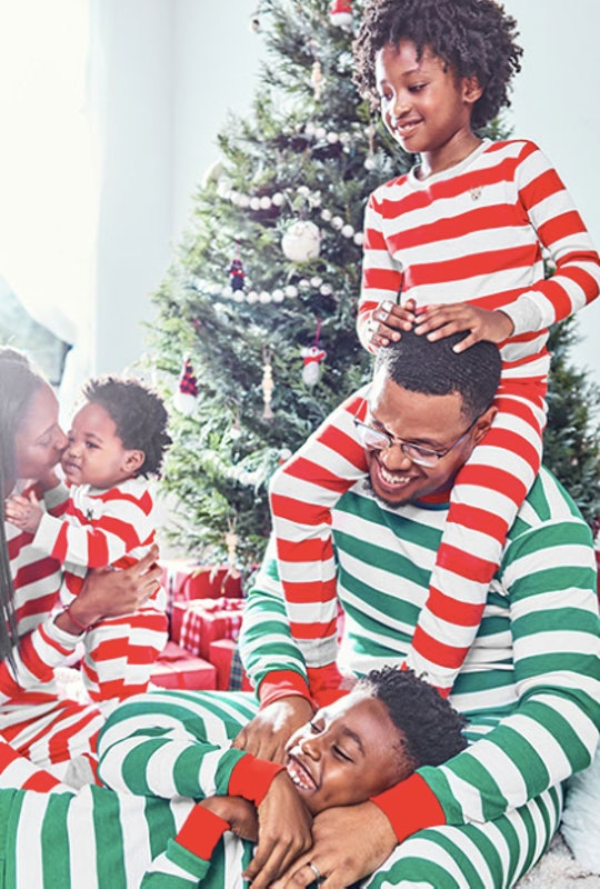 a family wearing striped holiday pajamas
