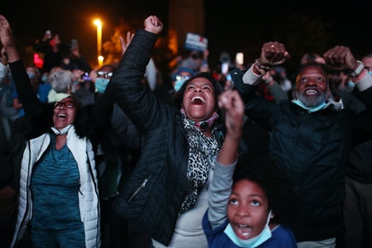 Jailyn Banks and King M (C-R) and others celebrate as President-elect Joe Biden arrives on stage at ...