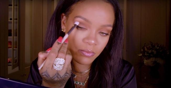 Rihanna holds Fenty Beauty eyeshadow brush