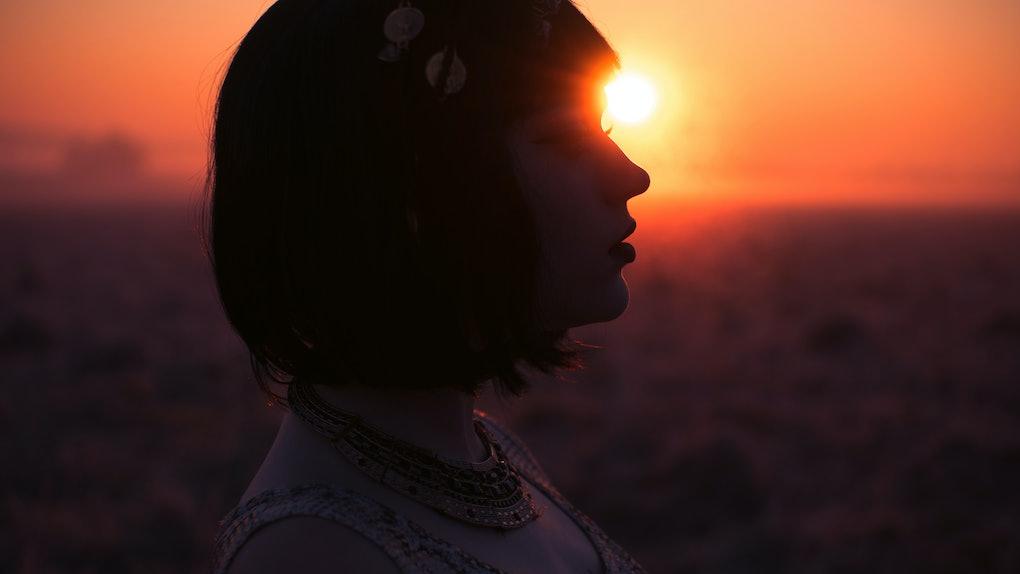 Silhouette of girl on sunrise