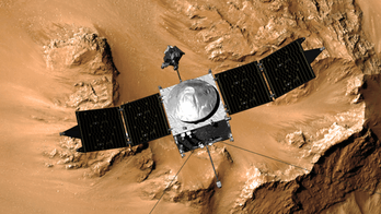 An artist's conception of MAVEN studying Mars.