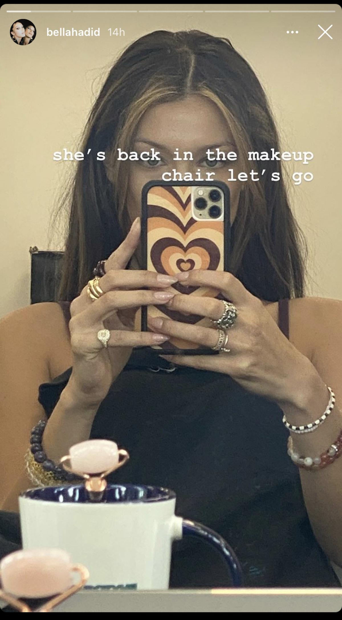 Bella Hadid in a mirror selfie showing off her new egirl hair.