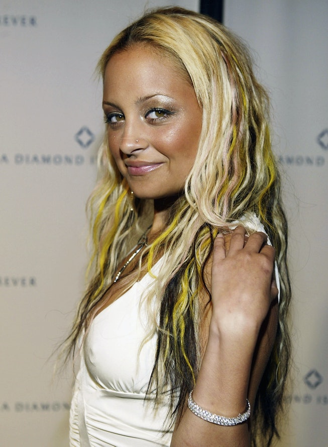 Nicole Richie with blonde hair that's highlighted yellow and black.