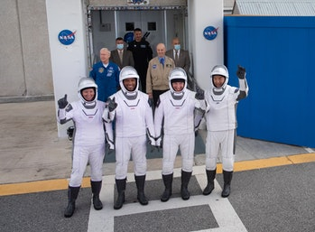 The crew walking out to the launchpad.