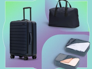 Three pieces of luggage are placed in front of a colorful backdrop.