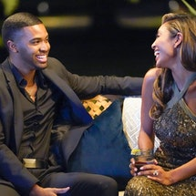 a photo of contestant Ivan sitting with Bachelorette Tayshia