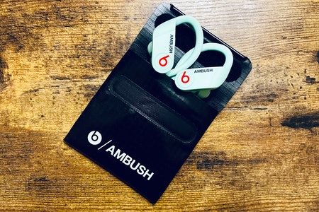 Beats x Ambush glow-in-the-dark Powerbeats earbuds.