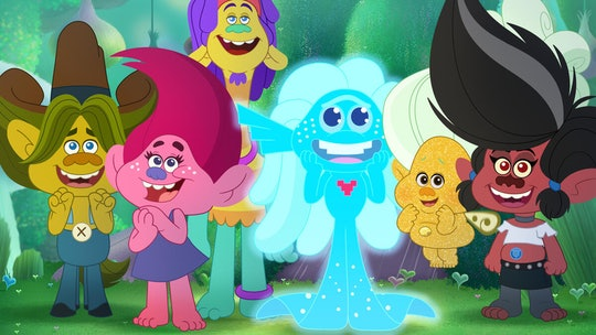 Six colorful cartoon trolls look up in gleeful excitement.