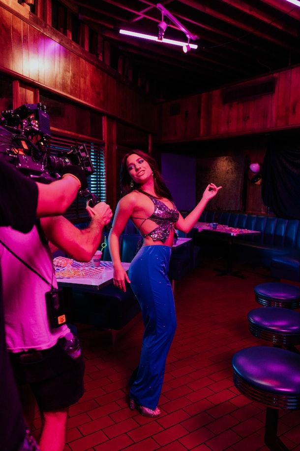 Zenzie Ziegler appears in her music video for 'Donuts.'