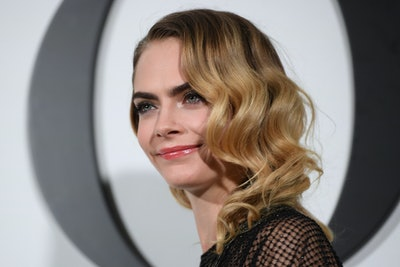 Cara Delevingne poses with a smile