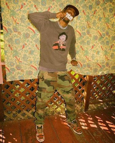 Travis Scott wearing Nike's SB Dunk Freddy Krueger.