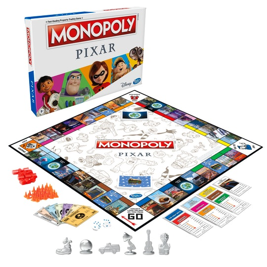 A picture of a Monopoly board featuring characters and places from the Pixar universe with Pixar themed pieces in front.