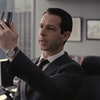 The actor Jeremy Strong playing Kendall Roy in the HBO series succession, on his phone, is a good example of a workaholic — albeit one who is also battling a substance abuse addidciton.