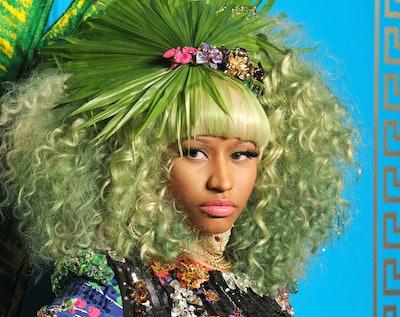Nicki Minaj with bright pink curly hair