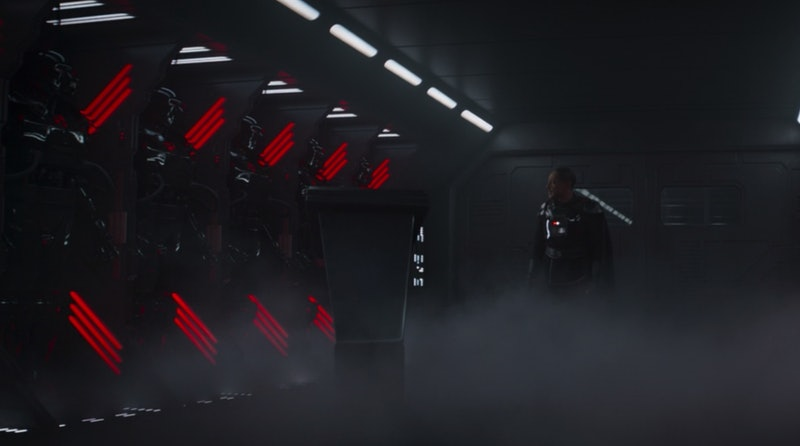 Moff Gideon looking at some mysterious dark suits at the end of 'The Mandalorian' Season 2, Chapter 12.