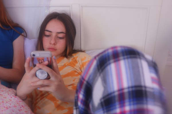 Teenage girl on her cell phone