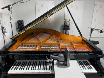 a piano with a haptic feedback tool