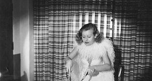 Fox actress Lillian Harvey carves the turkey for a Thanksgiving dinner, Hollywood, California, early...