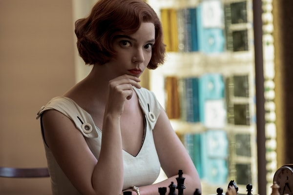 Beth Harmon (Anya Taylor-Joy) stares off and contemplates her next chess move in 'The Queen's Gambit.'