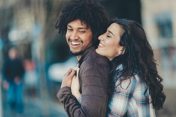 Biracial couple embracing