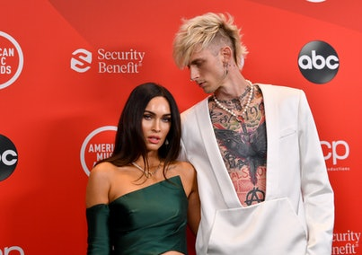 Megan Fox and Machine Gun Kelly pose together on the red carpet at the 2020 AMAs
