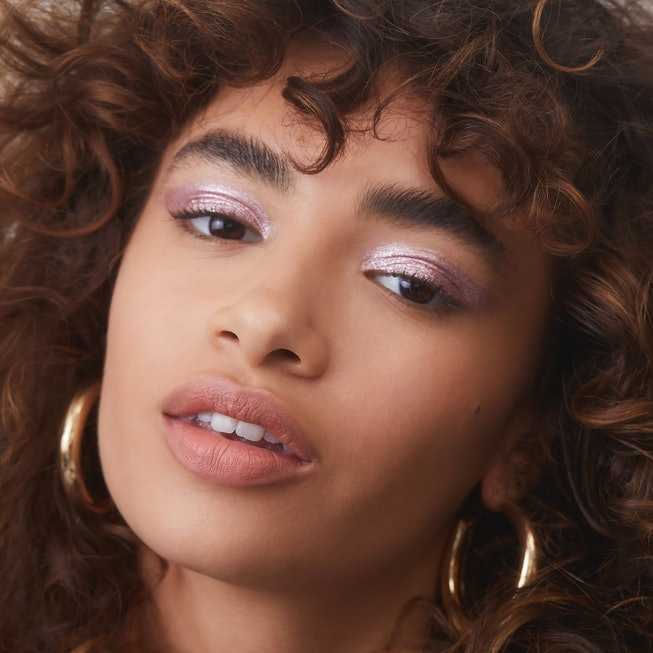 A model wears Liquid Metallic Eyeshadows