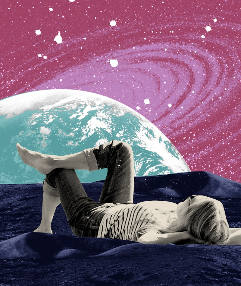 woman laying down by planet
