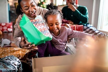 Child opening presents on Christmas morning