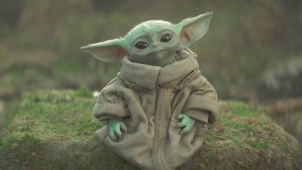 Baby Yoda — aka, Grogu — sits on a rock in 'The Mandalorian' series on Disney+.