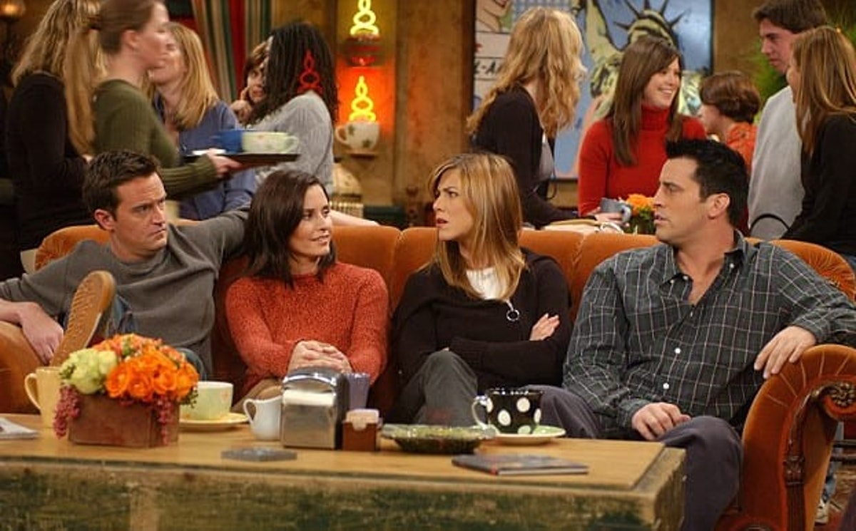 Chandler, Monica, Rachel and Joey from 'Friends' all sit on the couch in Central Perk.