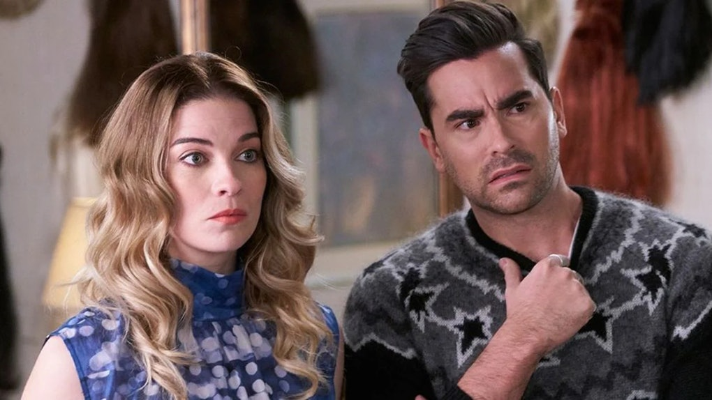 Alexis (Annie Murphy) and David (Dan Levy) look concerned at someone in 'Schitt's Creek.'