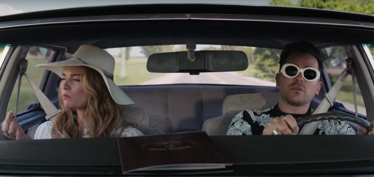Alexis (Annie Murphy) and David (Dan Levy) drive in a car on 'Schitt's Creek.'