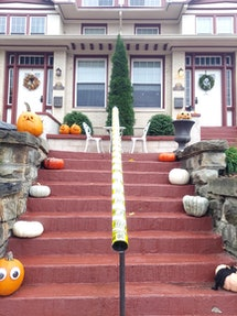 The view from the bottom of a steep set of stair; a candy chute awaits trick-or-treaters.